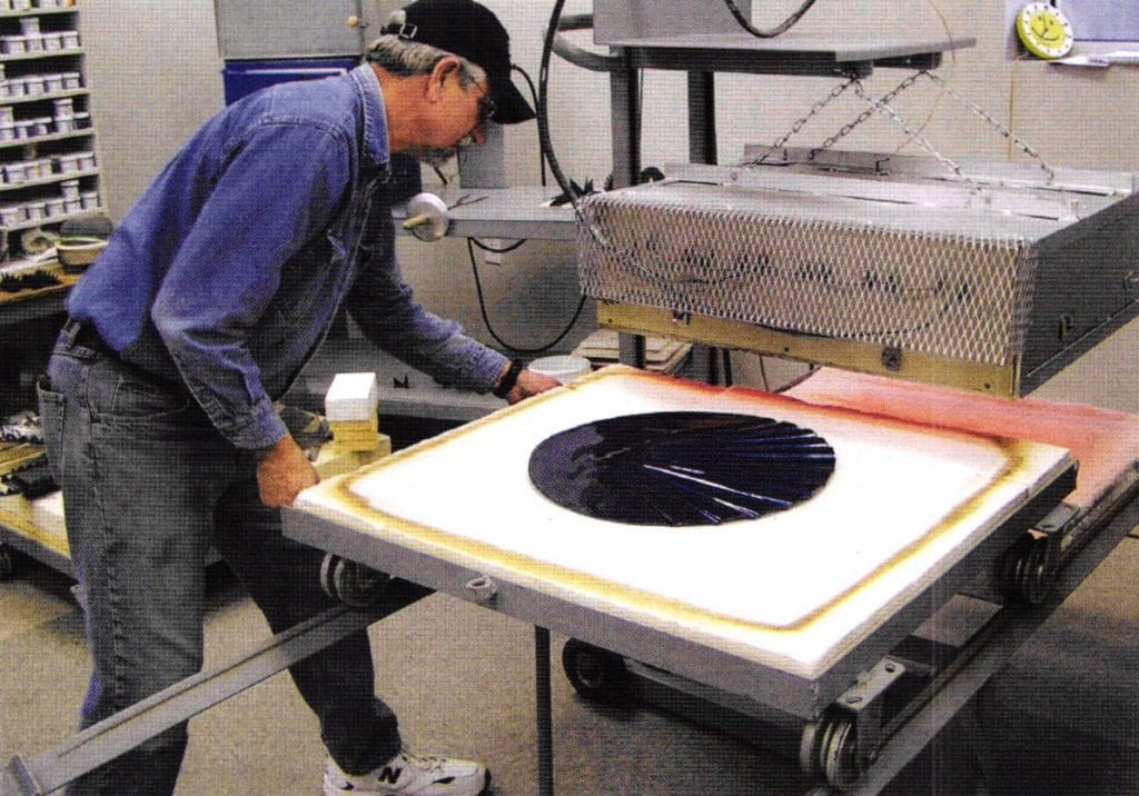 John Smith moving furnace base with enamel work under beating elements