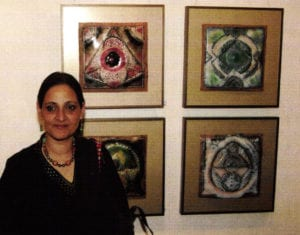 Jyoti Singh with works from the exhibition