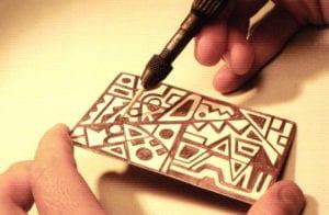Finishing the design using the scribing tool.