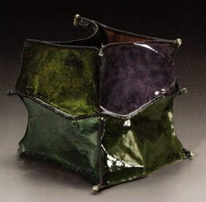 """Vessel #2193 """" Dance"""" by June Schwarcz, 2001 . Enamel on copper, 7.75""""x10""""x8""""."""